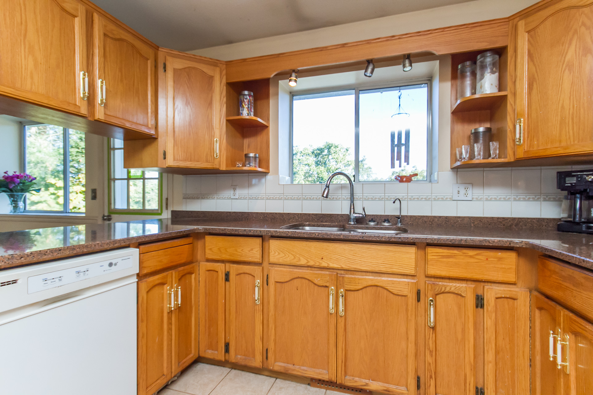 kitchen cabinets light setting of 5bdrm home on almost an acre in hatzic 20719